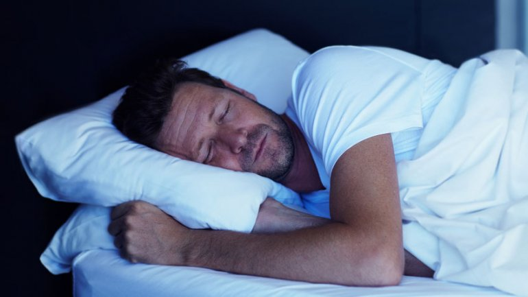 man-sleeping-bed-crop